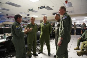 Combined Forces Air Component Commander, Air Commodore Chris Westwood briefs the Directors of the Combined Air Operations Centre (CAOC), (from left) Deputy Commander, Colonel David Lowthian, Captain John Alexander (Royal Canadian Air Force), Captain Charles Degilio (United States Navy - Reserve Component) and Group Captain Stuart Bellingham (RAAF). The briefing was conducted at the Combined Air Operations Centre during Exercise Rim of the Pacific (RIMPAC) 2014 at Joint Base Pearl Harbor - Hickham. *** Local Caption *** Air Commodore Chris Westwood is the Combined Forces Air Component Commander, the first time an Australian has been given this role. There is also a team of about 50 RAAF members in the AOC orchestrating the air campaign. Three AP-3C Orions are directly involved in the maritime patrols during the anti-submarine warfare phase. A number of 41 Wing Air Combat Officers are stationed with the Hawaiian Regional Operations Centre conducting air battle management operations for the exercise. Approx 200 aircraft are involved including about 90 fast jets, a large number of maritime patrol aircraft and a large number of helicopters as well as command and control aeroplanes – refuellers for example. About 4000 people contribute to the air campaign and about 200 people in the AOC. 22 nations are participating in RIMPAC 2014 including Australia, Canada, France, India, Indonesia, Japan, Malaysia, New Zealand, Republic of Korea, Singapore, the Philippines, Tonga, UK and the USA. China and Brunei will also take part in RIMPAC this year, for the first time. 2014 is the largest iteration of Exercise RIMPAC ever conducted with around 25,000 personnel, 49 surface ships, six submarines and more than 200 aircraft from across the Pacific Rim.